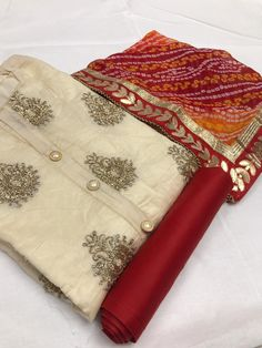 Hira- Moti White&Red Color: White&Red Fabrics: Top- Chanderi Silk With Glitter WorkBottom - SantoonDupatta- Bandhni With Gota Patti Lace Kurti Neck Designs, Dress Neck Designs, Kurti Designs Party Wear, Blouse Designs, Salwar Designs, Lehenga Designs, Cotton Silk, Printed Cotton, Printed Kurti