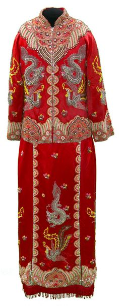 Wedding Jacket, China, mid 20th century, rayon, metal fastener, metal sequin, glass bead. The extensive bead embroidery on this woman's two-piece suit is reminiscent of the hand-sewn embellishment found in European couture. It echoes the symbolic designs of imperial dragon robes, with dragons, birds and phoenixes floating in the air above borders of stripes and flowers. The metal zipper on the jacket is a modern and somewhat discordant finishing touch.