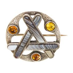 Antique Victorian Scottish Agate Cairngorm Citrine Silver Brooch Pendant c 1890 | From a unique collection of vintage brooches at https://www.1stdibs.com/jewelry/brooches/brooches/