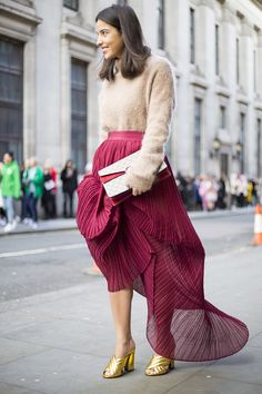 Slouchy jumpers make the perfect partner to longline pleated skirts and metallic accessories. #Topshop #LFW