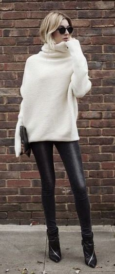 Cozy oversized winter white sweater with black leather pants.