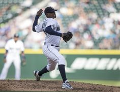 Roenis Elias Photos Photos - Starter Roenis Elias #29 of the Seattle Mariners delivers a pitch during the sixth inning of a game against the Texas Rangers at Safeco Field on September 7, 2015 in Seattle, Washington. The Rangers won the game 3-0. - Texas Rangers v Seattle Mariners
