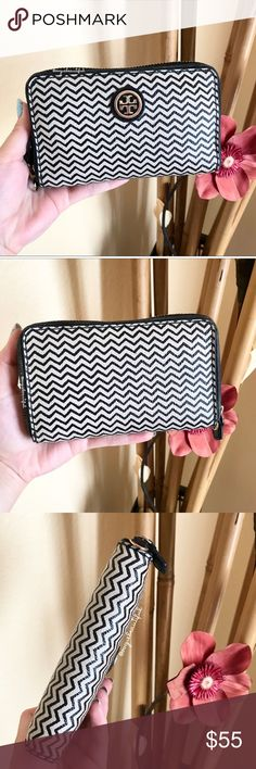 Tory Burch Chevron Medium Size Wallet 100% authentic Tory Burch zip around chevron printed leather wallet - medium size - priced due to preloved condition, some light  wear to the lining around the zipper, some tarnishing to hardware - interior has 3 large slots on the side, central coin pouch, and another slot on the side as well  - DIMENSIONS: 6 inches across x 3.6 inches in height -  📎Measurements are approximate 📷 Colors may vary slightly from photos  💰Bundle for the best deal  ❌No…