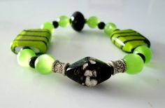 Lime Green and Black Bracelet by RoseyCreek on Etsy, $8.00 Black Bracelets, Beaded Bracelets, Lime, Trending Outfits, Unique Jewelry, Handmade Gifts, Green, Etsy, Vintage