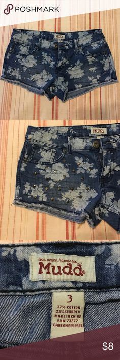 Junior women's, Mudd brand shorts Dark denim jean shorts, with white flower accent on back and front. Silver studs on right leg, two front pockets, and two back pockets, great condition. Mudd Shorts Jean Shorts