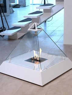 Design Fireplace Shaped Like the Louvre Pyramid