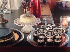Three Stooges cupcakes, individual white cake with edible black sparkles, and black and white cheesecake