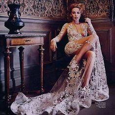 Kylie Minogue in a Gorgeous embroided white see through couture gown. High fashion editiorial!