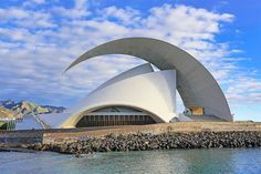 17 Striking Concrete Buildings Around the World Santiago Calatrava's auditorium in Santa Cruz de Tenerife Stadium Architecture, Concrete Architecture, Concrete Building, Unique Architecture, Chinese Architecture, Futuristic Architecture, Architecture Office, Pavilion Architecture, Minimalist Architecture
