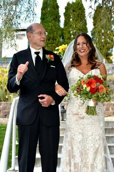 Tammy & Tripp Wedding with a walk down the isle by Dad. Flowers by Full Bloom @ the Pybus Market