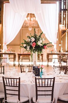 Very pretty but a good example of TOO MUCH green within the centerpiece. (Looks like less focus on flowers and too much green filler). This is a great example of my chiavari chair color (mahogany) and white / ivory table linens. Wedding Desserts, Wedding Themes, Wedding Decor, Wedding Venues, Wedding Gallery, Wedding Photos, Wedding Centerpieces, Wedding Table, Camarillo Ranch