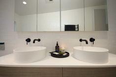 Double basin vanity with black tapware and above bench Fineline basins l Generous bathroom storage with face level storage and deep vanity drawers l Black tapware and handmade white subway tiles. See the rest of this bathroom and where to source the products...