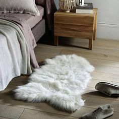 Livio Faux Sheepskin Bedside Rug La Redoute Interieurs Soft and comfortable, this classic style brings sheer Scandinavian hygge to your bedroom. In either coal grey or cool white, this faux sheepskin rug. White Rug, White Area Rug, Blue Area Rugs, White Faux Fur Rug, Faux Sheepskin Rug, Pink Room, Shag Rug, Bedroom Decor, Furniture
