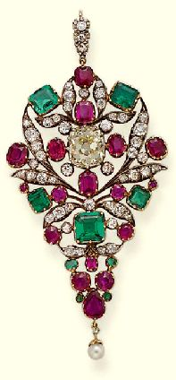 AN ANTIQUE DIAMOND, RUBY AND EMERALD PENDANT Of openwork drop-shaped design, the central light yellow cushion-cut diamond within ruby, emerald and diamond surround to the pearl drop and diamond line suspension loop, adapted, mounted in silver and gold, early 19th century, 7.3 cm. high