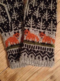 A gorgeous pattern for mittens that includes trees and foxes.