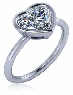 Bezellia 2 Carat Heart Cubic Zirconia Bezel Set Solitaire Engagement Ring available in 14k gold, 18k gold and platinum by Ziamond. #ziamond #cubiczirconia #heart #bezel #solitaire #engagement #ring 2 Carat, Bridal Sets, Solitaire Engagement, Valentine Day Gifts, 18k Gold, White Gold, Wedding Rings, Jewels, Pendant