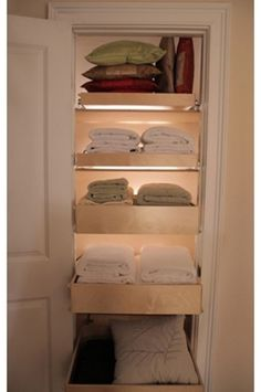 I love pull out shells/trays and they are perfect for a linen closet to make retrieving and putting away stacks of folded linens easier. The lighting makes everything easier to see, making it more likely for you to find what you need and make better use of all your available space.