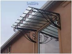 Image result for IRON AND GLASS AWNING