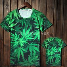 We can probably guess what any dude wearing this bright green all-over marajuana cannabis leaf print t-shirt likes to do in his spare time!