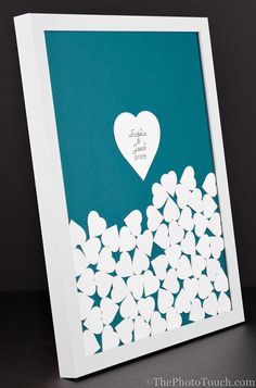 Wedding Guestbook - Plinko Style. There are various frame choices along with custom color hearts and background. The center heart is inscribed with your information. A beautiful wall hanging to remember the beautiful day.