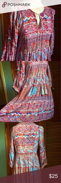 Beautiful BoHo Umgee swing dress Gorgeous dress from Umgee! So perfect for summer! It can be worn as a dress or swim cover-up! BoHo floral designs in reds blues greens purple white etc. In good preloved condition. Unfortunately this just doesn't fit me anymore. Two string ties in front and three-quarter sleeves. Flowy and light weight! Dresses