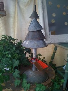 old funnels? make a rustic Christmas tree.  this is so cute!  Especially for the man cave.  :)
