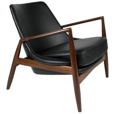 Ib Kofod-Larsen 'Seal' Lounge Chair, 1950s   From a unique collection of antique and modern lounge chairs at https://www.1stdibs.com/furniture/seating/lounge-chairs/