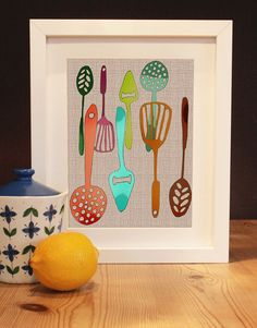 love all these spatulas and spoons! fun kitchen art