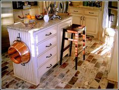 Brick floor - A house we looked at in Louisiana had this in the kitchen. Thin Brick, Brick Flooring, Kitchen Cart, Liquor Cabinet, Kitchen Appliances, Country Kitchens, Louisiana, Wall, Chicago