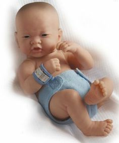 JC Toys La Newborn Asian- Real Boy by JC Toys Group, Inc.. $44.99. Scented Doll. 14  inches Long. Includes hospital bracelet. All vinyl material. Anatomically correct. From the Manufacturer                This 14 inches  La Newborn doll is available as anatomically correct boys and girls. They come with their own real life diaper and hospital bracelet, making them look like real life newborns.                                    Product Description                18508 Fea...