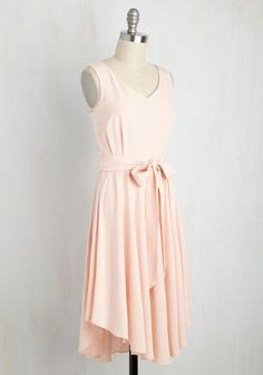 The arrival of this pink, ModCloth-exclusive dress into your life puts an end to your ponderings over the perfect frock. Elegantly flowy and endlessly flattering, this scoop neck style spotlights soft pleats at the bodice, and a curved hemline that makes every step appear like a choreographed sway!