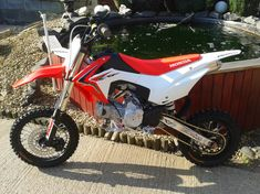 modded crf 110 from the uk 110 Dirt Bike, Cool Dirt Bikes, Honda Motorcycles, Cars And Motorcycles, Pit Bike, New Honda, Rear Brakes, Stuff To Do, Road Bike