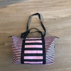 Victoria's Secret Duffle Only used once. Very little wear. Some small stains inside. Two very small faint stains on the outside. Could easily be washed out. Victoria's Secret Bags Travel Bags