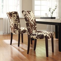 Add an extra touch of personality with cow print dining room chairs. They are neutral enough to work well in many spaces and many styles of home decor.
