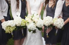 I love the simplicity of these bridesmaids' bouquets. Hydrangeas?