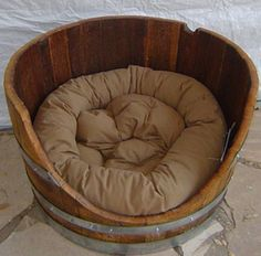 Wine barrel dog bed. This would be EXCELLENT for Boston :).  how cute i would put this in the garage or covered padio