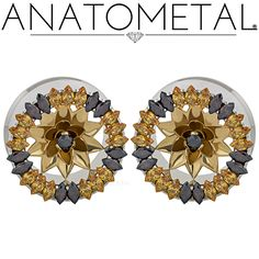 "1"" Marquise Eyelets in ASTM F-138 stainless steel with bronze Water Lily Inserts: Amber Yellow, Brown CZ, and Black CZ (center) gemstones"
