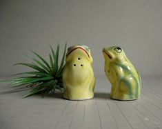Invite this charming couple to your table. These vintage frog figurine salt and pepper shakers were made in Japan. They sport cork stoppers. Fun set for the summertime table. • shakers measure about 2 3/4 high x 1 3/4 • in lovely vintage condition, no wear, chips or cracks, corks in good condition as well  • more vintage table finds! www.etsy.com/shop/gazaboo?section_id=18797675  • enter our shop → gazaboo.etsy.com  • thank you for visiting gazaboo