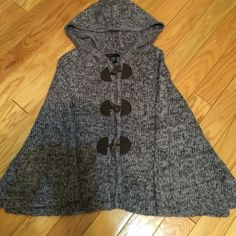 BCBG MAXAZRIA sweater . BCBG MAXAZRIA sweater cape. Has 3 brown toggle closures. Lavender and brown with metallic thread. Also has a hood. Excellent condition. BCBGMaxAzria Sweaters Shrugs & Ponchos