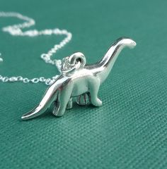 $28 - ever since that bronty sneezed on the whiny girl in jurassic park I have loved these gentle giants.  Gotta love the photography and staging here too - Sterling brontosaurus dinosaur necklace gift for her