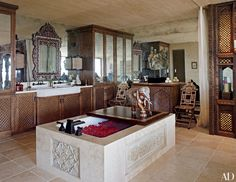 In Cher's Los Angeles master bath, which was designed by Martyn Lawrence Bullard, Indian stone panels wrap a tub from Waterworks, and a pair of inlaid Syrian chairs flank a commode from Linda Horn. Asian Bathroom, Next Bathroom, Bathroom Ideas, Bathroom Inspo, Bathroom Designs, Modern Bathroom, Architectural Digest, Transitional Wall Mirrors, California Homes