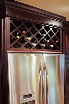 Gallery « Red River Remodelers- wine rack built in above refirgerator; dark expresso cabinets;