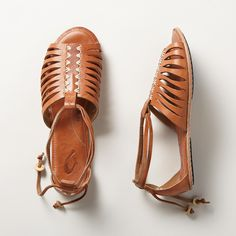 HIKINA SANDALS�--�Hurachi-style, adjustable sandals from Olukai� bring you centuries-old comfort in soft, hand-stitched leather. Imported. Whole sizes 6 to 11. These are running large, please size down one size.