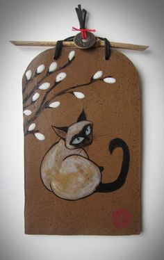 Siamese with pussywillow painted on brown stoneware with bamboo hanger and lucky coin accent. Selection of hanging tiles available at the Torpedo Factory Art Center in Alexandria, Va. by Tracie Griffith Tso of Reston, Va.