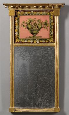 Federal Eglomise Mirror. Carved Wood, Gilt-Gesso and Eglomise Painted Mirrored Glass. Probably Massachusetts. Circa 1815.