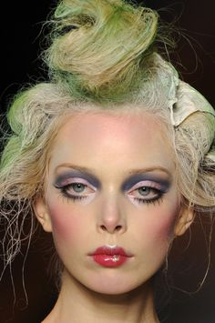 dramatic makeup. love the painted lips!