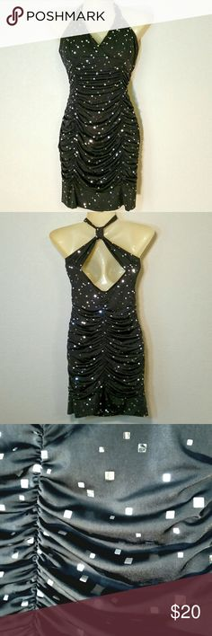 """Silver """"Confetti"""" Prom Dress Sparkly silver confetti and all over ruching make this dress a perfect fit for prom night. Taboo Dresses Mini"""