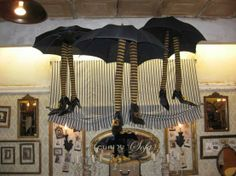 Witches hung from ceiling - Need: striped leggings, cheap black shoes and black umbrellas
