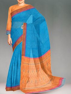 Shop online designer pure rajasthani kota cotton saree at unnatisilks.com Blue color pure handloom Rajasthani kota cotton saree with matching blouse.This cotton sari has got all over self color block prints along with brown block printed orange border on either side.And it has block printed orange elegant pallu.It is suitable for casual and corporate wear. To purchase online Kota cotton sarees please visit our site http://www.unnatisilks.com/