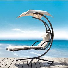 Blissfull Summer Days-This Delano Dream Chair Chaise Lounge is the pinnacle of outdoor style and comfort. This adjustable lounge chair features beige colored fabric and a powder-coated bronze on the metal.